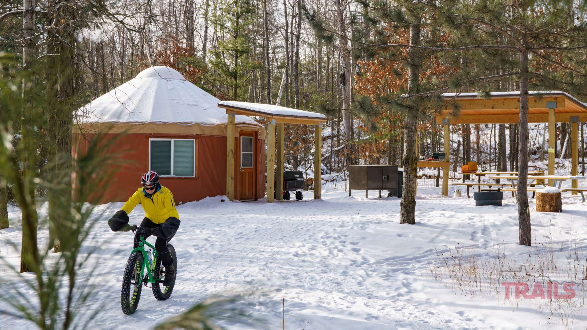 Riding a fat bike in snow at the Cuyuna Country State Recreation Area Yurts