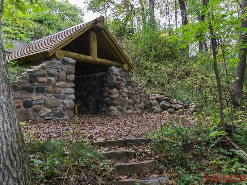 Restored WPA trail shelter on the banks of the Mississippi