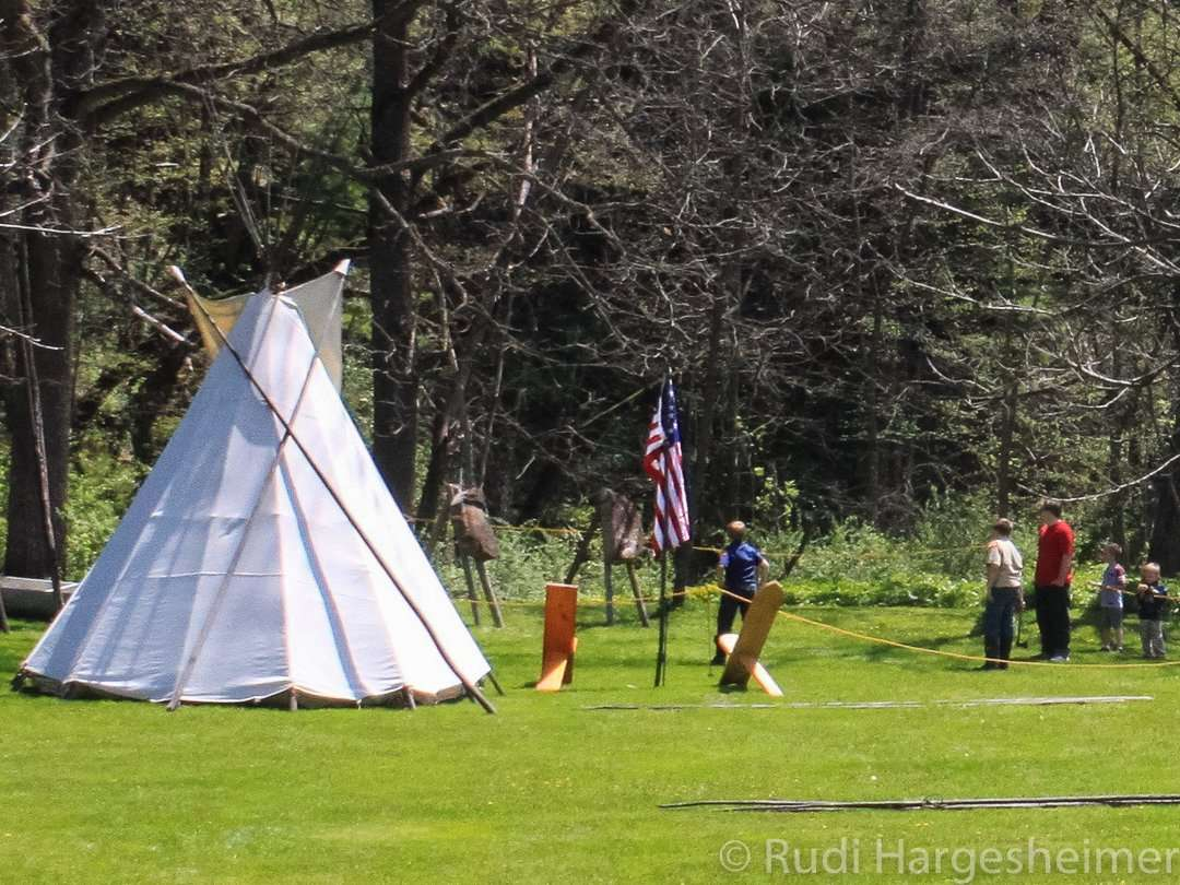Teepee building demonstration at the annual Carley Bluebell Festival