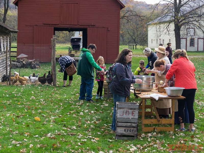 Making apple butter is hands-on for visitors and performers at Forestville/Mystery Cave State Park