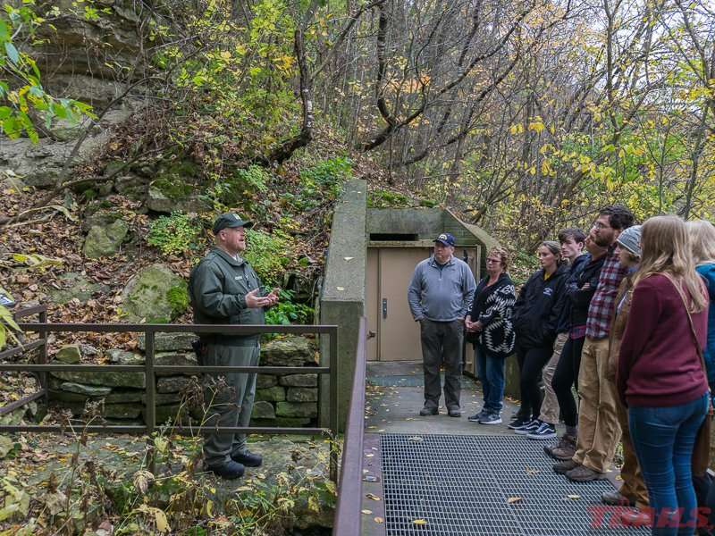 Tour group at the entrance to the cave at Forestville/Mystery Cave State Park