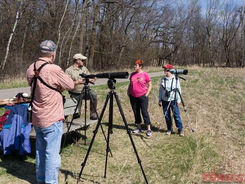 A park naturalist with spotting scopes near the eagles nest at Glendalough State Park
