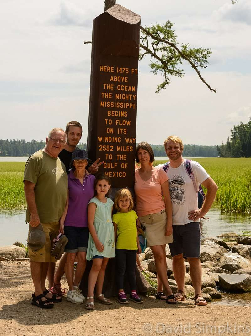 A family photo at the Mississippi headwaters is a must for many visitors at Itasca State Park