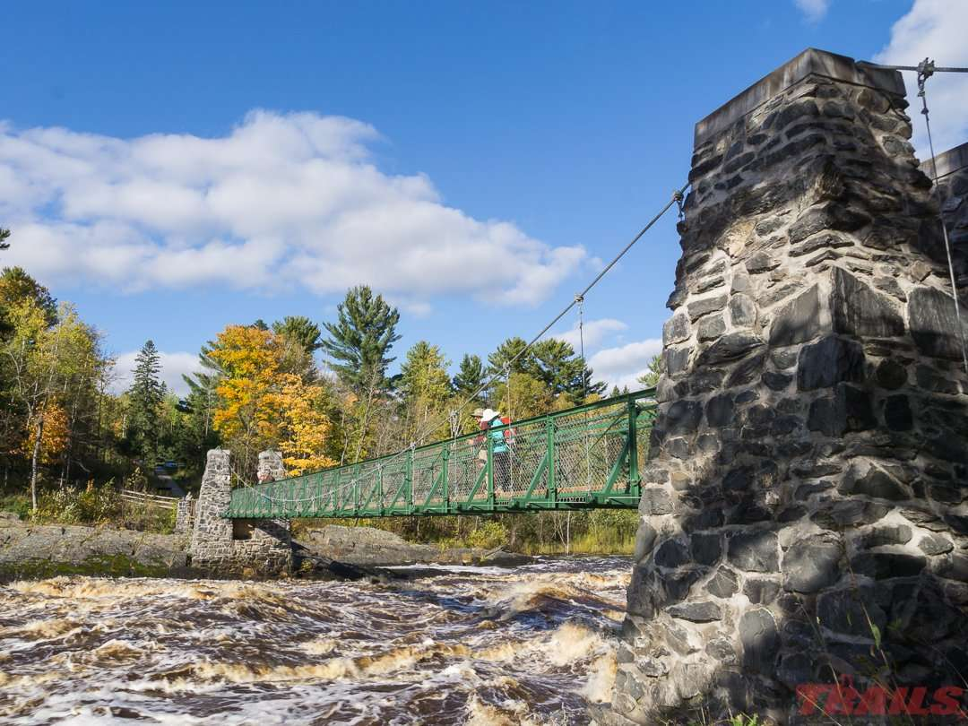 The iconic swinging bridge at Jay Cooke State Park