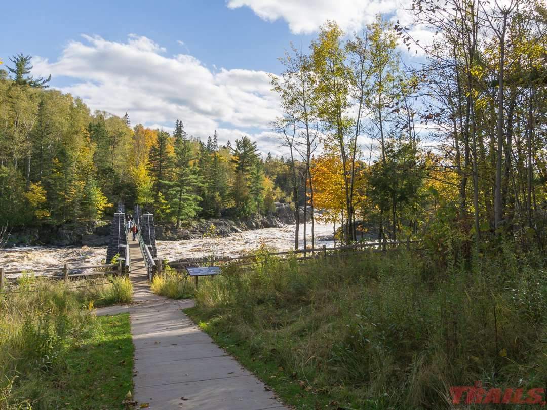 Fall scenery with the swinging bridge at Jay Cooke State Park