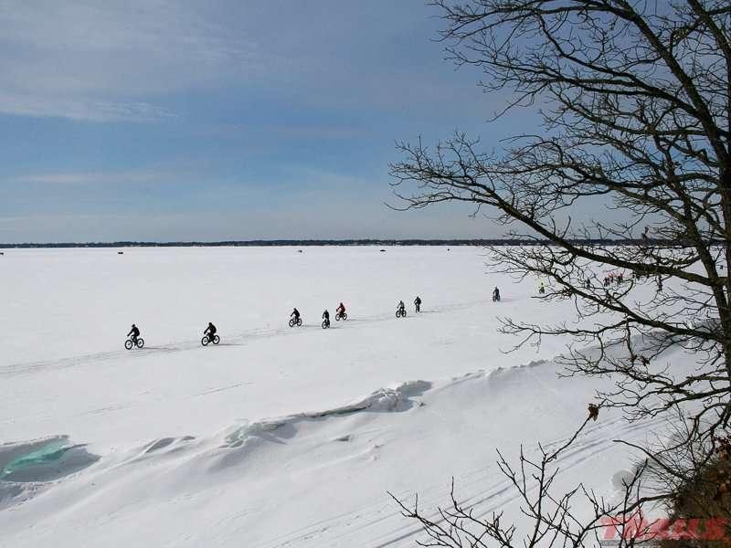 Mass start of the Northland Fat Bike Rally on Lake Bemidji at Lake Bemidji State Park