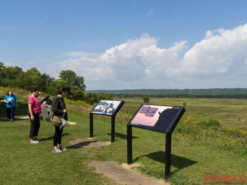 Interpretive Signs tell the story of the bison at the overlook near Seppman Mill at Minneopa State Park