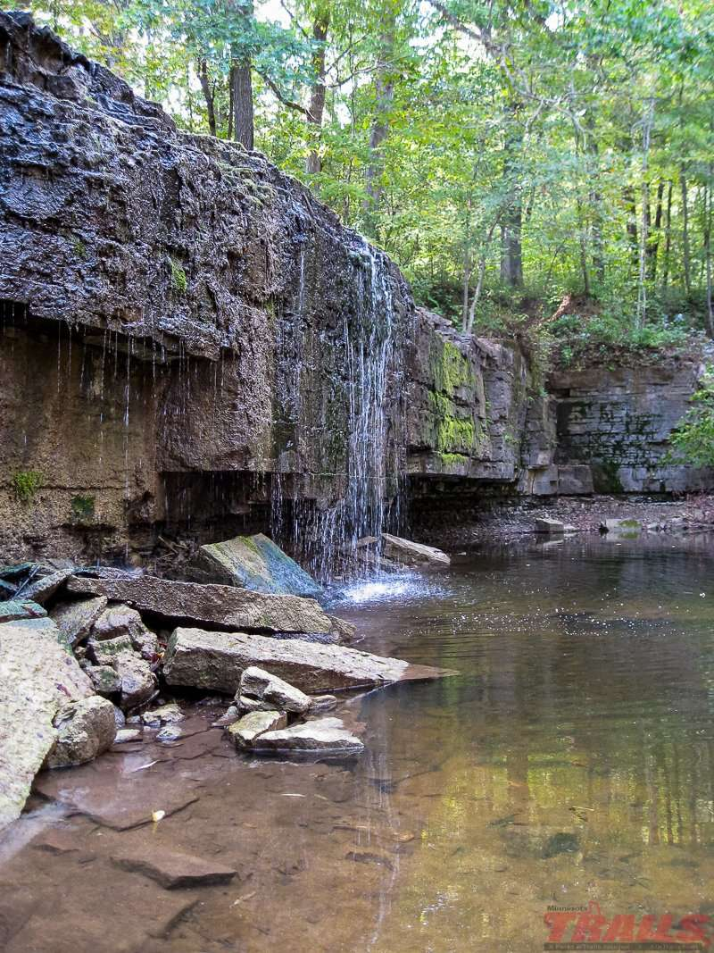 A tranquil Hidden Falls on a quiet day at Nerstrand Big Woods State Park