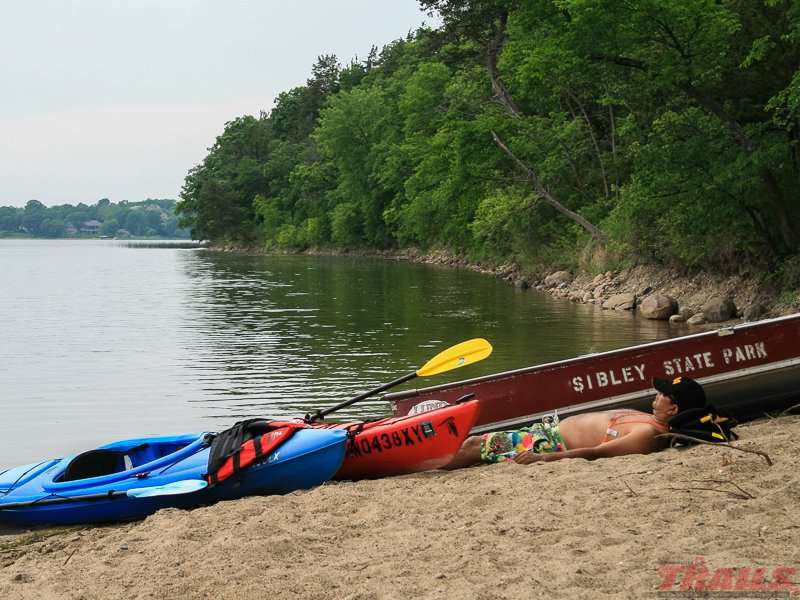 Taking a nap on the beach after a day of kayaking at Sibley State Park