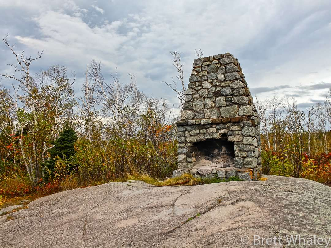 An abandoned stone fireplace sits atop of High Point. Its origins are unknown at Split Rock Lighthouse State Park