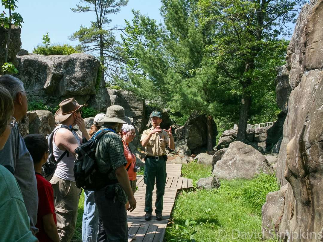 Naturalists educate visitors about the pothole formations in the park at Interstate State Park
