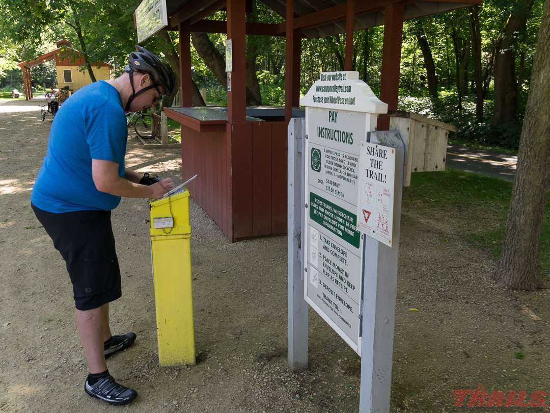 Cyclists need to purchase a wheel pass at area businesses or one of these self-pay stations on the Cannon Valley Trail