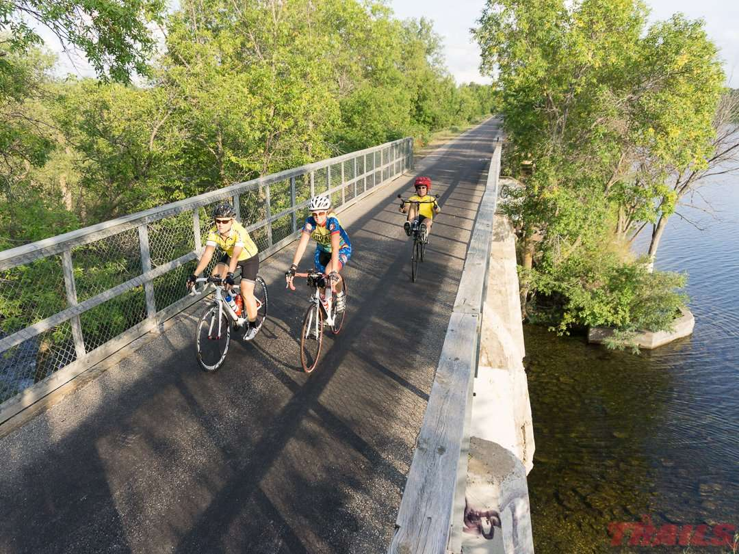 Members of the Big Ole Bike Club pass by Lake Cowdrey in Alexandria on the Central Lakes State Trail