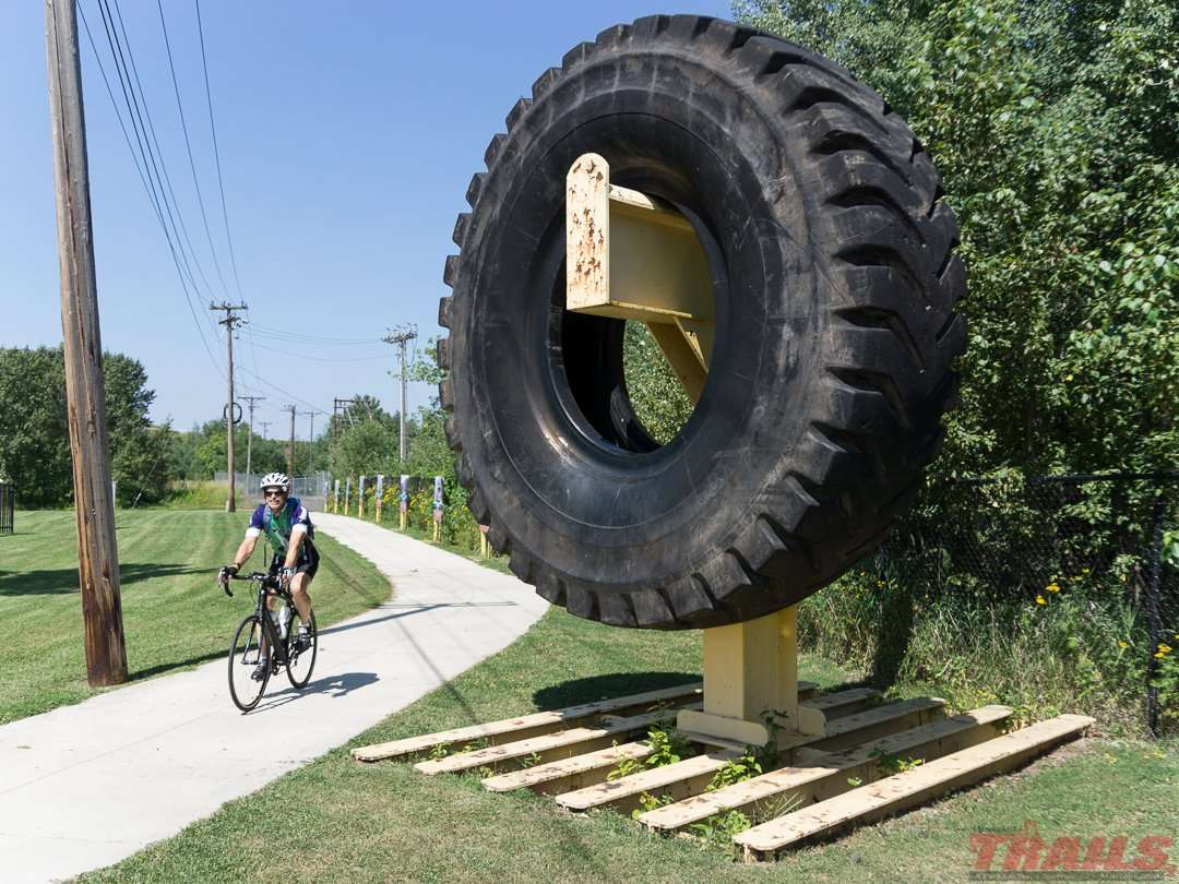 Communities along the trail display retired mining artifacts like this loader tire in Mountain Iron on the Mesabi trail