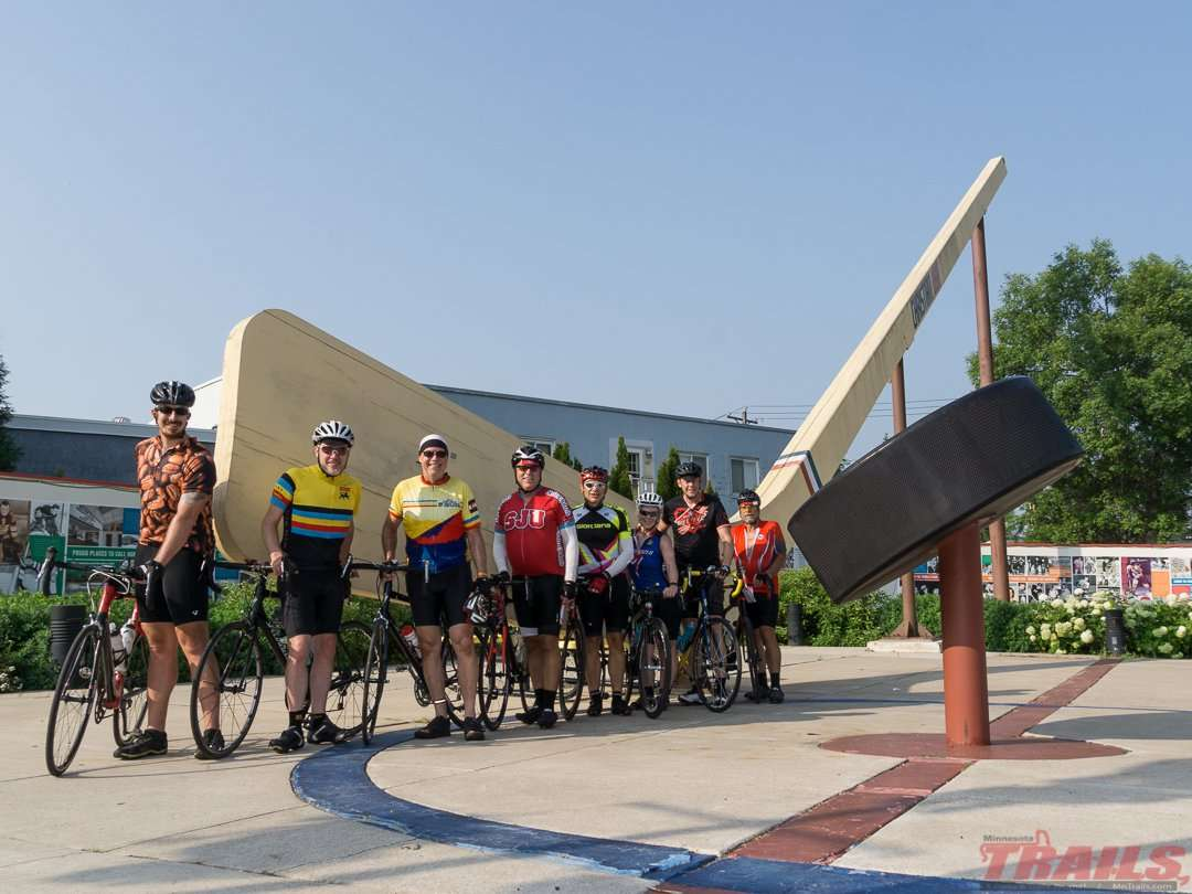 Riders pose in front of the world's largest hockey stick in Eveleth. The US Hockey Hall of Fame is just a few blocks away