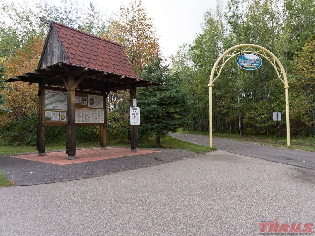 Kiosks and familiar yellow arches mark access points like this one in Coleraine on the Mesabi Trail