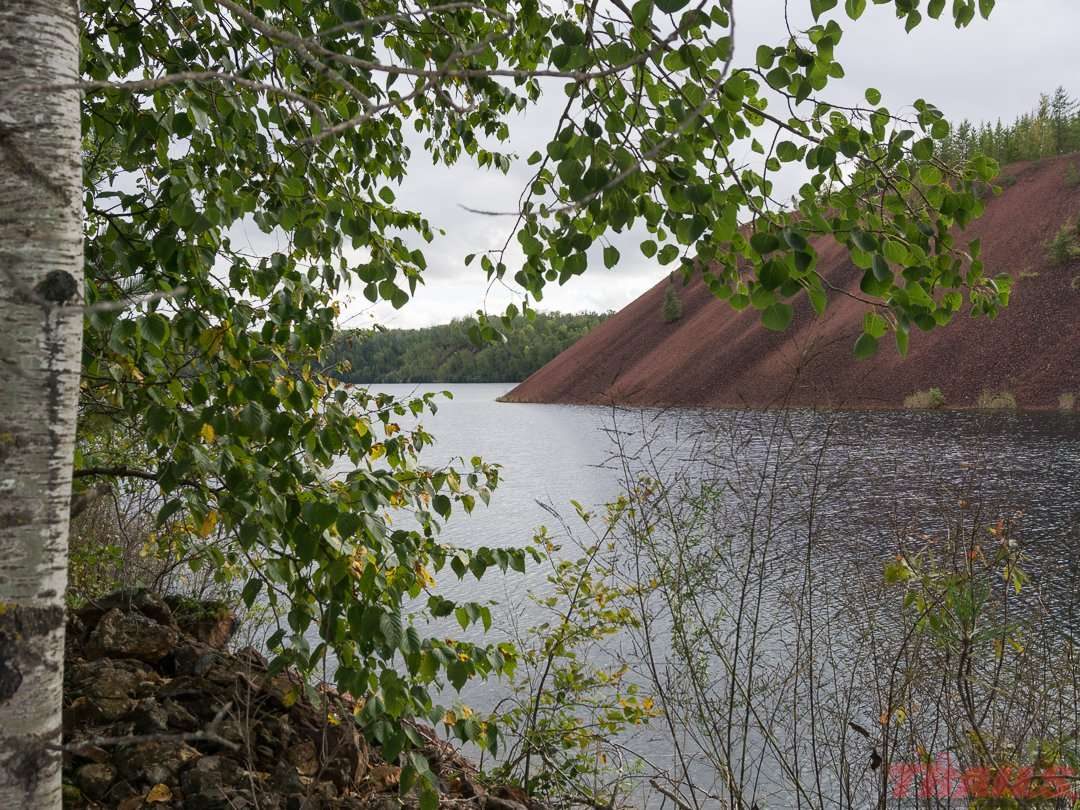 View of an overburden hill and mine lake near Grand Rapids on the Mesabi Trail