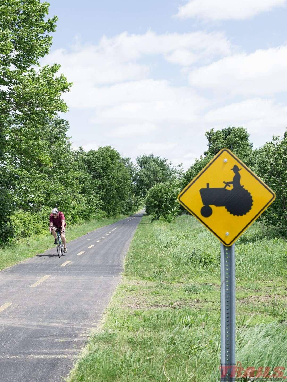 Tractor crossing sign near Mayer on the Dakota Rail Regional Trail