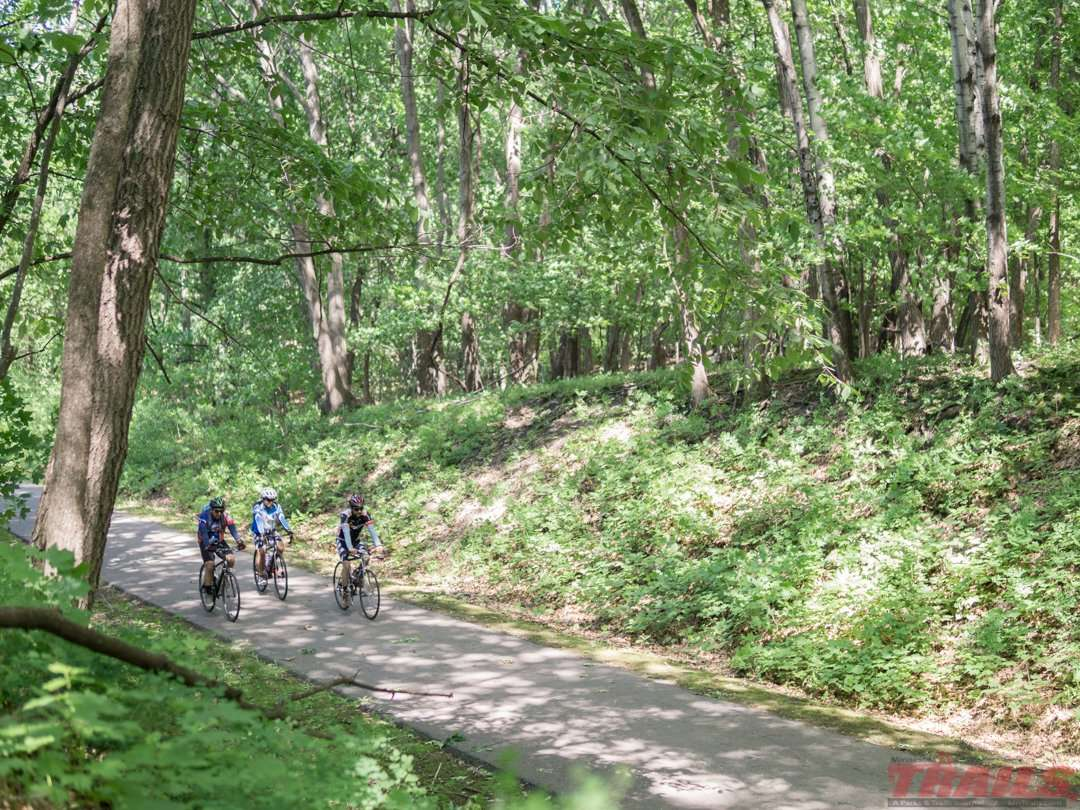 The trail travels through some heavily wooded areas, though you're never too far away from civilization on the Dakota Rail Regional Trail