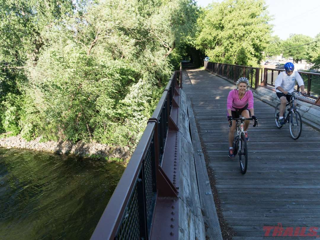 Biking between the lakes in Spring Park on the Dakota Rail Regional Trail