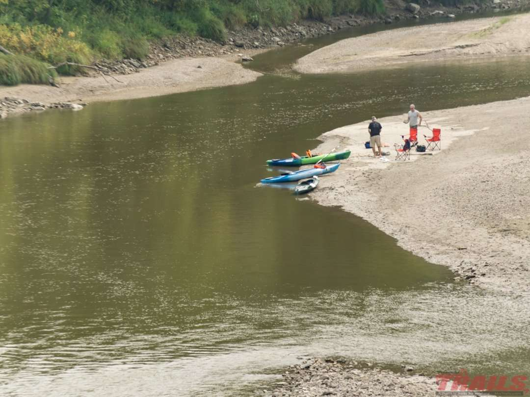 Kayakers take a shore lunch on the banks of the Le Sueur River on the Red Jacket Trail