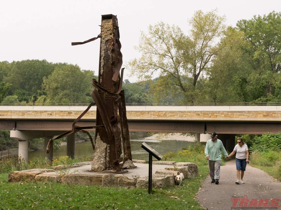 A bridge support damaged in a 2010 flood was pulled from the river and is now displayed at Red Jacket Trail Park