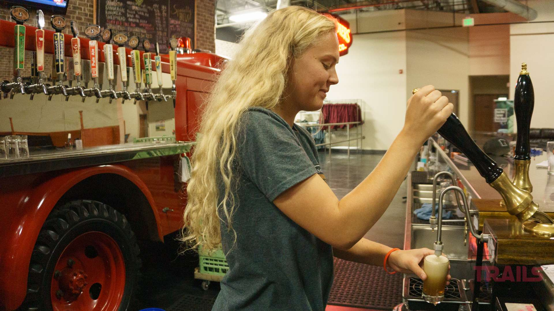 pouring beer in the Brau Bros Tap Room