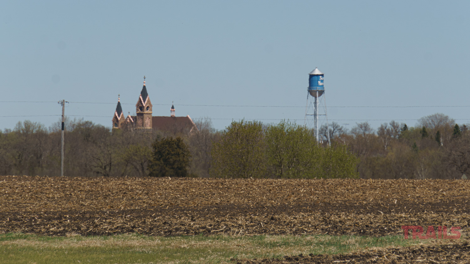 View of New Munich, MN from a distance with Immaculate Conception Church and water tower