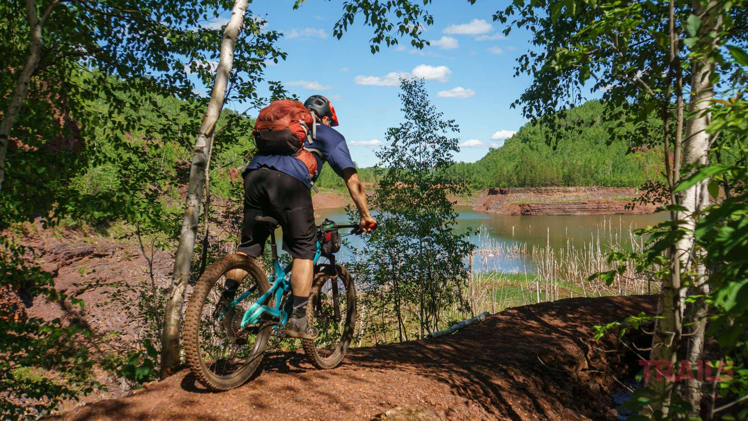 Mountain biker on a path by a lake