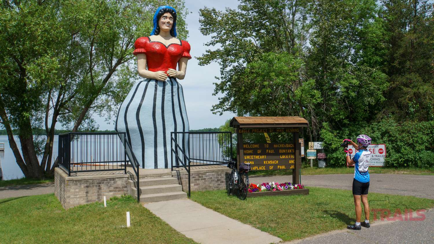 A woman takes a photo of the Lucette statue in Hackensack, MN