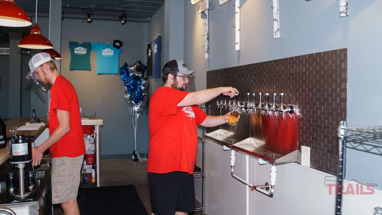 A beertdender pours a beer