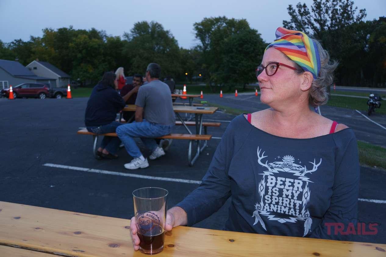 A woman at a picnic table