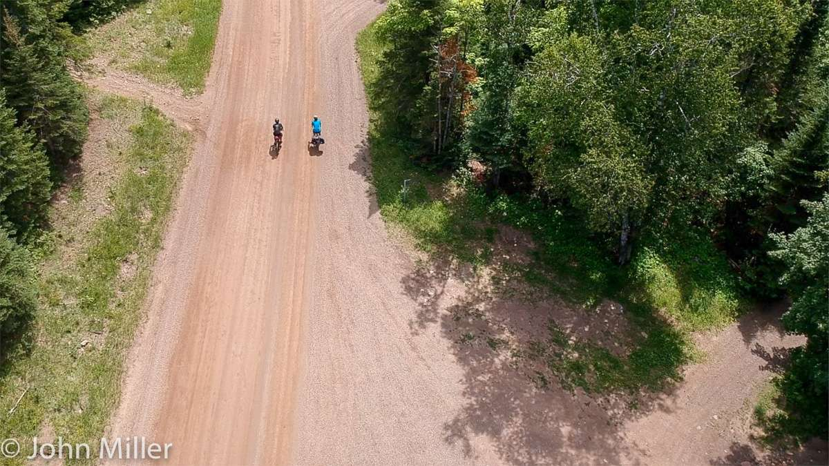 Arial view of cyclists on a gravel road