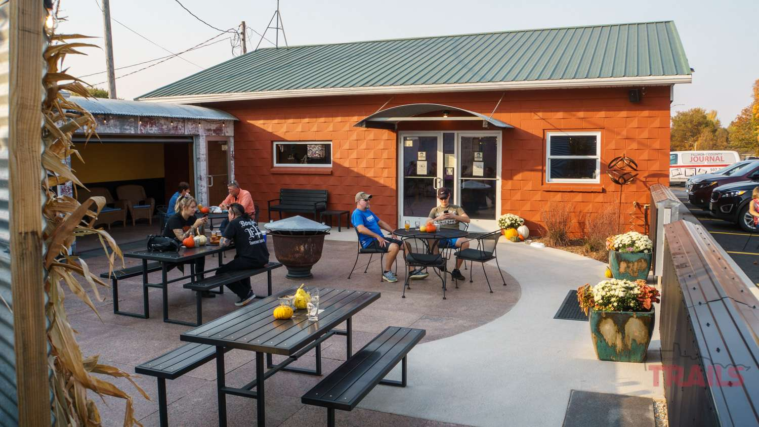 Patrons drinking beer on a patio