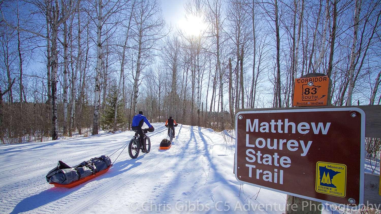 Fatbiking through a wintery forest