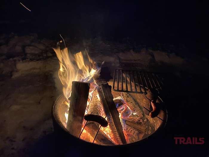 Roasting wieners over a bonfire