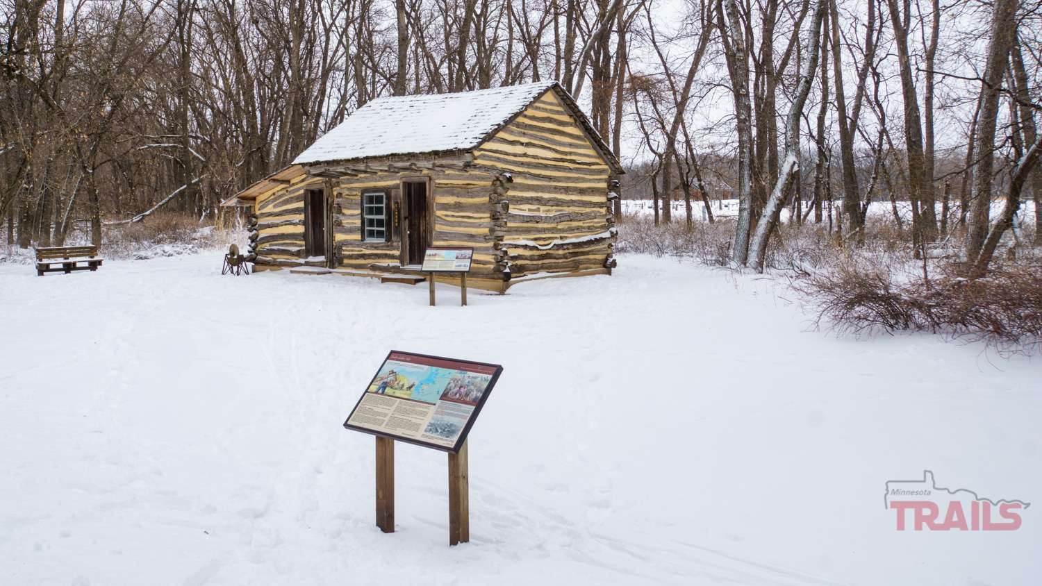 An early settler's cabin in the snow