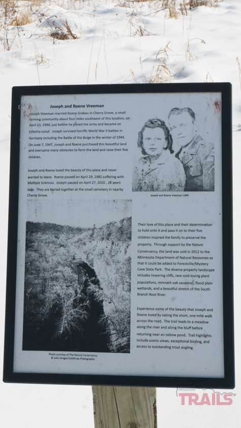 A sign describing the history of the Palisade Trail parcel at Forestville/Mystery Cave State Park