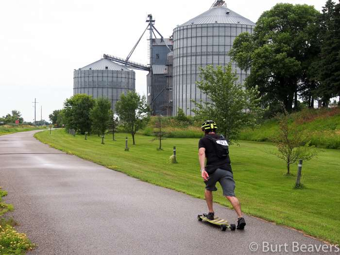 A skateboarder on a trail in rural MN