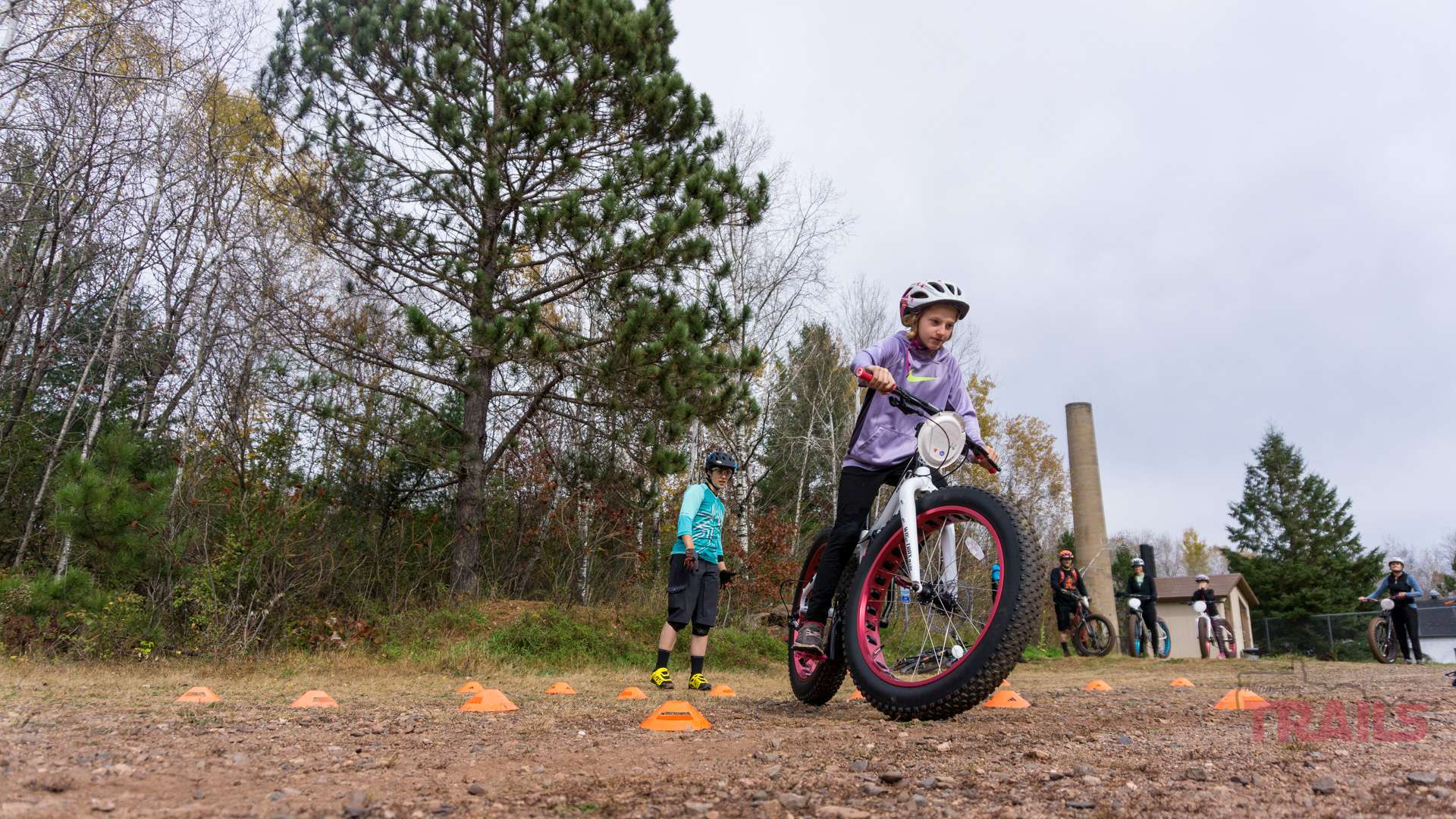 A young girl rides a fat tire bike