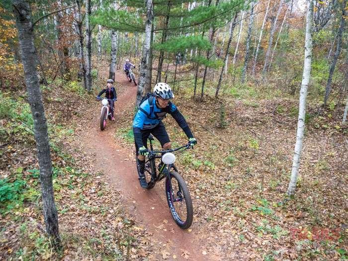 A man rides a mountain bike on a trail