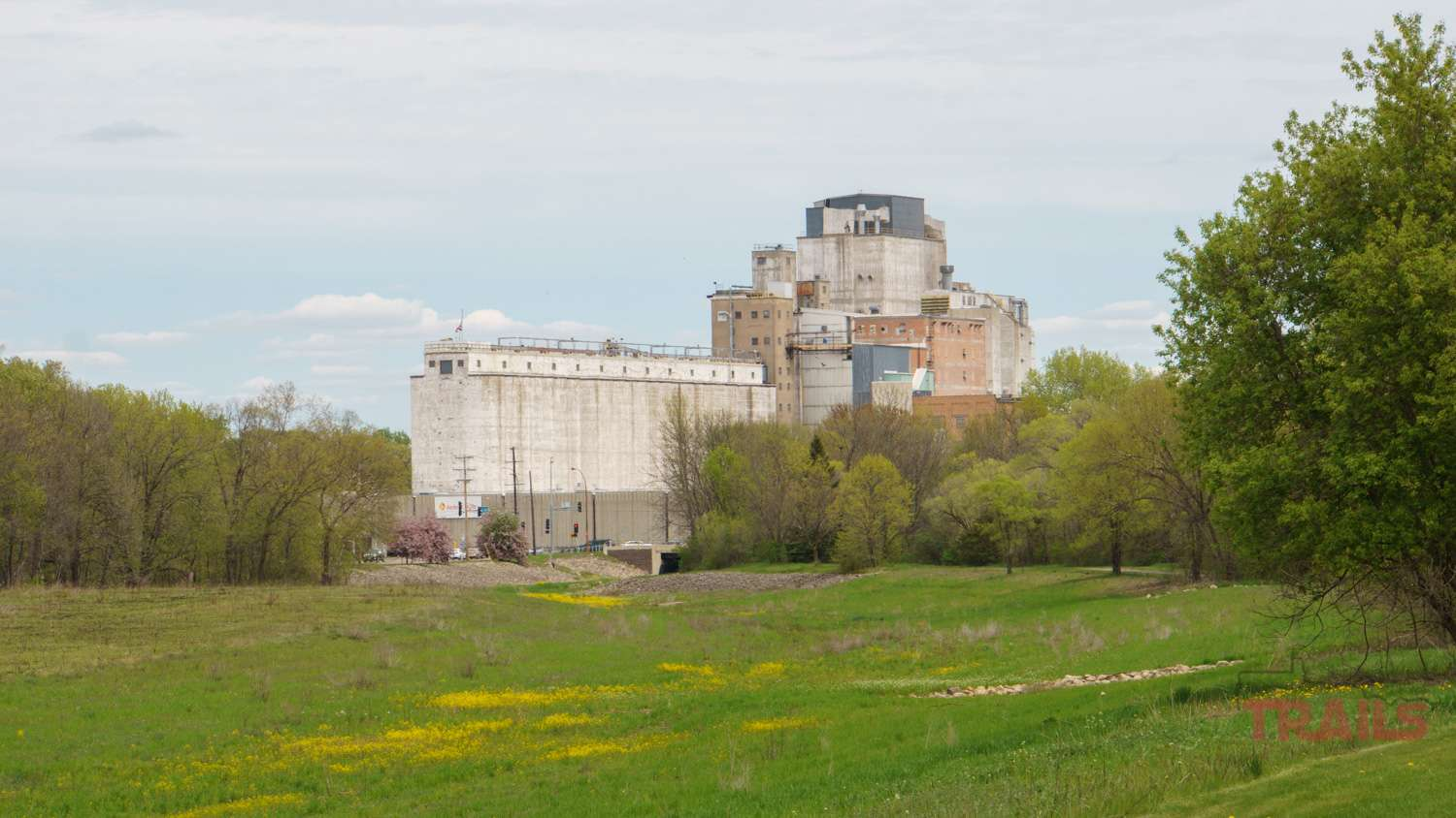 A scenic view of Hastings' Ardent Mill building at Vermillion River Linear Park