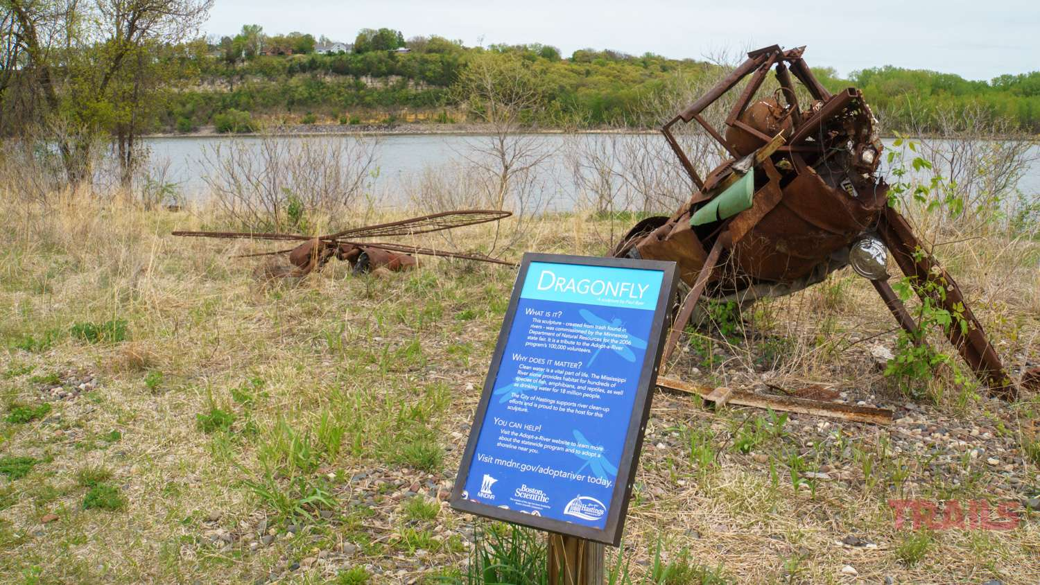 A sculpture built from rusty metal trash sits along the Mississippi River in Hastings, MN