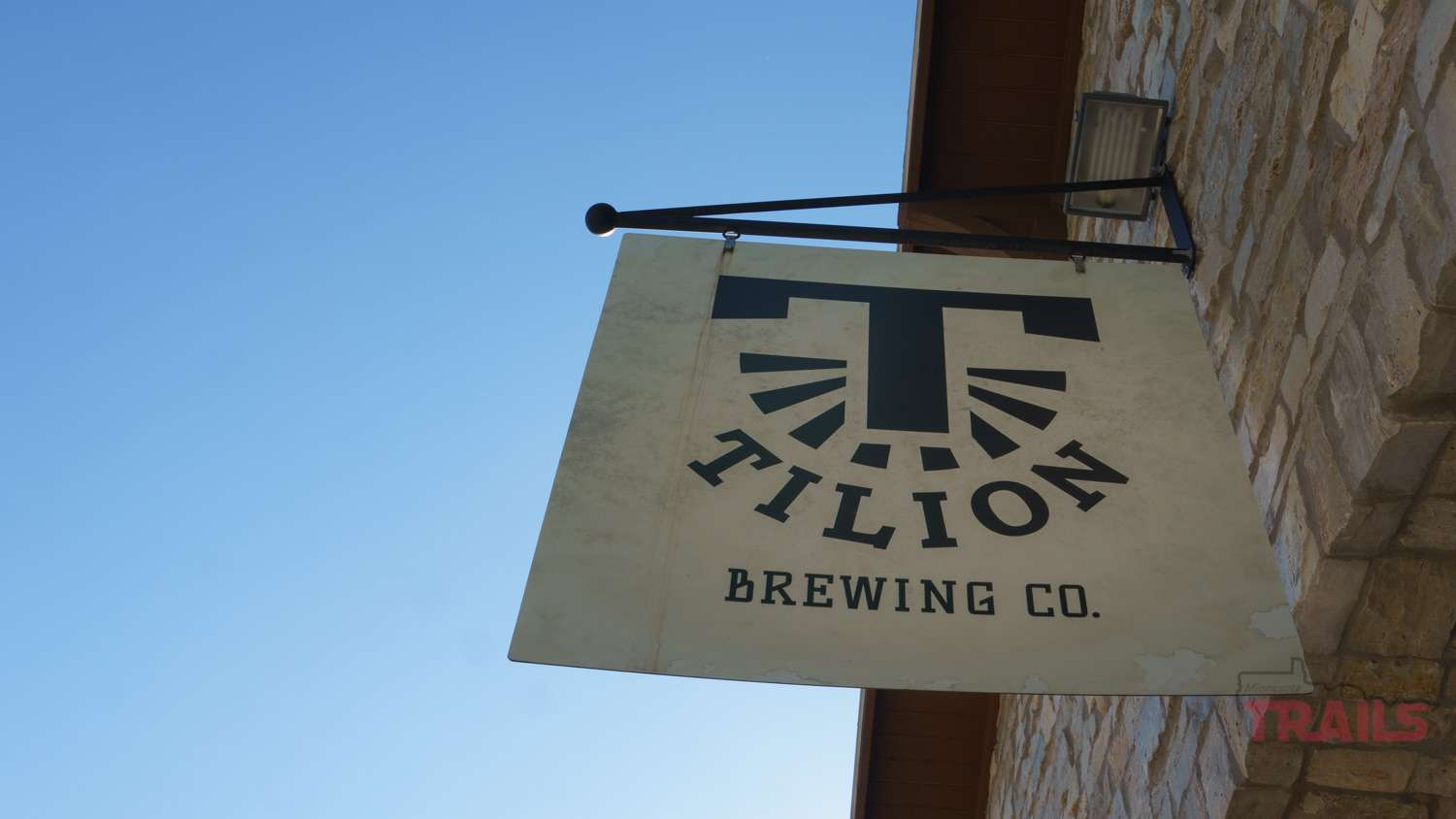 Tilion Brewing sign hanging over the entrance to the brewery
