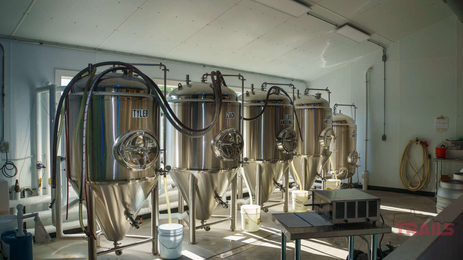 Shiny stainless steel tanks in a brewery