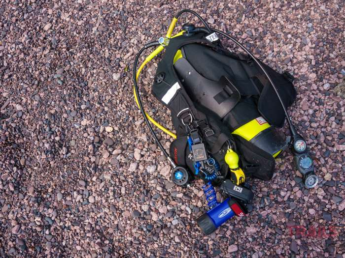 An oxygen tank and other diving equipment sit on the beach at Split Rock Lighthouse State Park