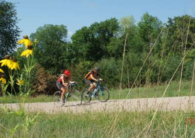 A man and a woman ride their bikes at the inaugural Bluenose Gopher 50 Gravel Race