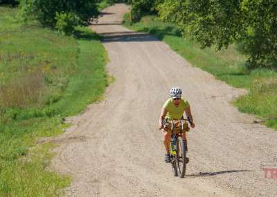 A woman rides her bike at the inaugural Bluenose Gopher 50 Gravel Race