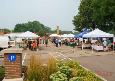 Vendor booths at an outdoor farmers market in the summer in Lakeville MN