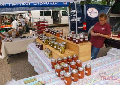 Jellies and jams at an outdoor farmers market in the summer in Lakeville MN